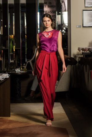 magenta silk top, red trousers