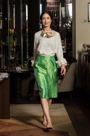 White ruffled top, green silk skirt